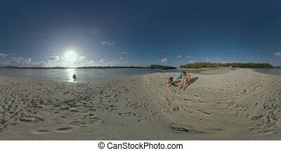 360 VR Parents and child relaxing on the beach of Mauritius...