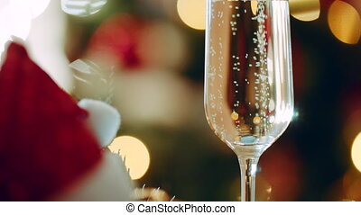 Close up shot of glass filled with champagne. Decorated...