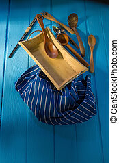 wood cookware over blue wooden table background.