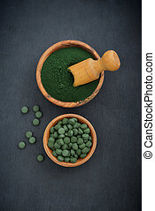 Spirulina - Ground spirulina and spirulina in pills over...