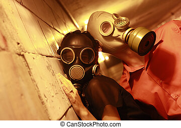 Struggle for a survival - Married couple in gas masks in a...