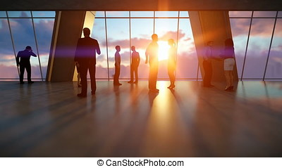 Businessmen talking, office against sunset
