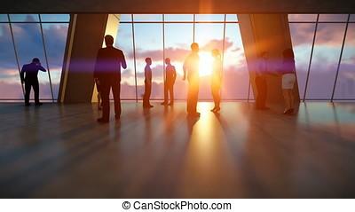 Businessmen talking, office against sunset