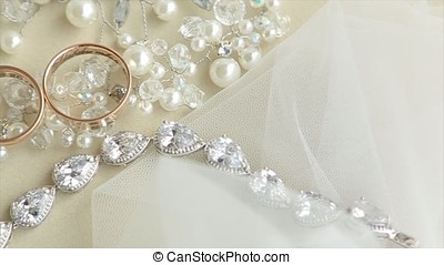 Wedding rings and rose. Wedding jewelry and rings. The...