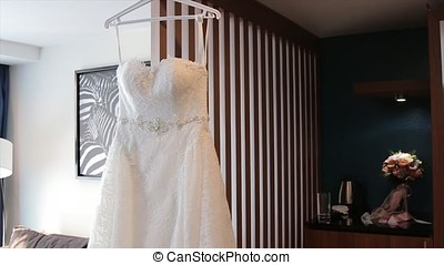 White Wedding dress on a shoulders, before ceremony. Wedding...