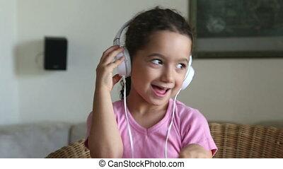 Girl listen to music - Shot of Girl listen to music