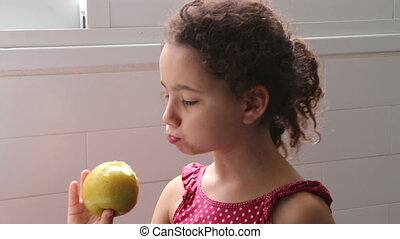 young girl with an apple