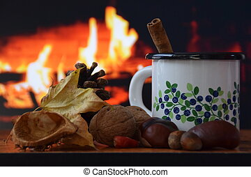 cup of warm drink by the fire