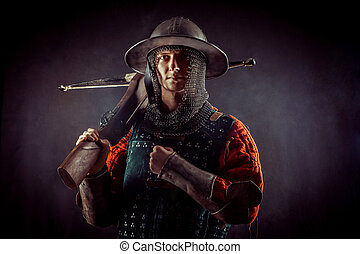 Young crossbowman with bow in medieval costume
