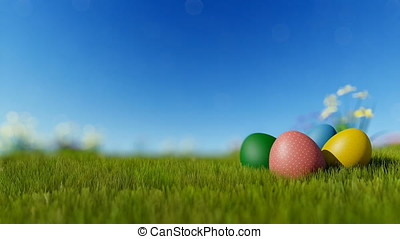 Easter eggs on green meadow over blue blurry sky