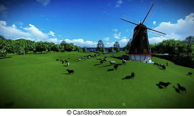 Sheeps and windmill on green meadow