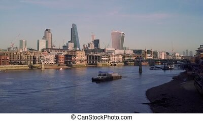 View to London City from the Thames embankment. With The Walkie Talkie building.