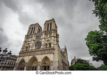 Notre Dame Cathedral in Paris with dark clouds - Dark clouds...