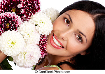 woman - Smiling woman with flowers Close up