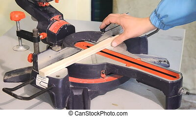 Circular saw for furniture manufacturing - Man using...
