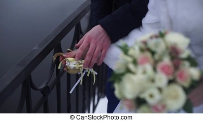 Wedding symbol, lock in hands of bride and groom. Newlyweds...