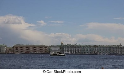View Winter Palace in Saint Petersburg from Neva river. Russia. Boat floats on Niva river past the winter Palace in Saint Petersburg. Hermitage Museum. Vasilevsky Island, And Frotress
