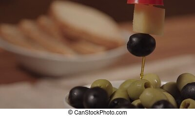 Canape with cheese and black olives.