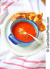 Hot tomato soup with cheese sandwich - Overhead view of...
