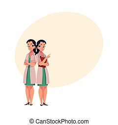 Two woman doctors in medical coats standng together