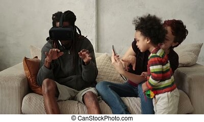 Interracial family spending time together at home - Happy...