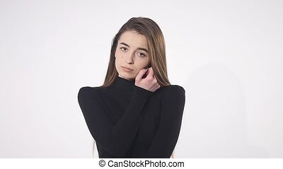 Sad young beautiful girl thinking over white background