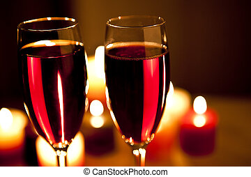 red wine and candles - two glasses of red wine with candles...