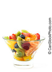 Fruit salad in crystal bowl isolated on white background
