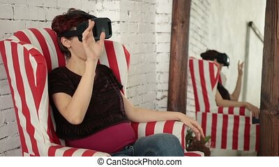 Woman playing game in virtual reality glasses - Smiling...
