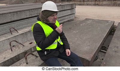 Construction worker smoking