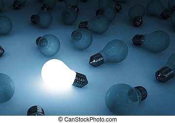 bulb glowing -  a single light bulb glowing