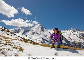 hiker in the Pyrenees in spring with snow, col du Soulor - a...