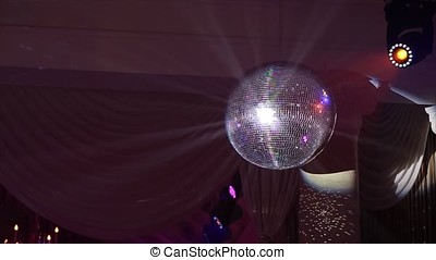Disco ball with bright rays, night party background. disco...
