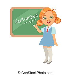 Llittle girl standing near the blackboard and writing word September, a colorful character isolated on a white background