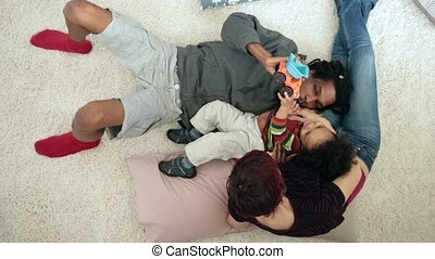 Top view of positive parents with child relaxing - Top view...