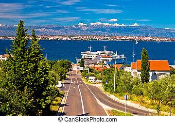 Island of Ugljan ferry port and Zadar view with Velebit...