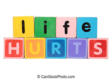 life hurts in toy blocks - toy letters that spell life hurts...