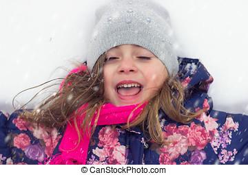 Little girl enjoying the snow