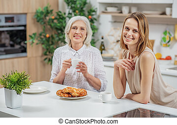 Cheerful young woman spending time with her parent -...