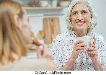 Friendly family talking in kitchen - Waist up portrait of...