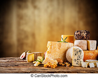 Various kind of cheese served on wooden table, traditional...