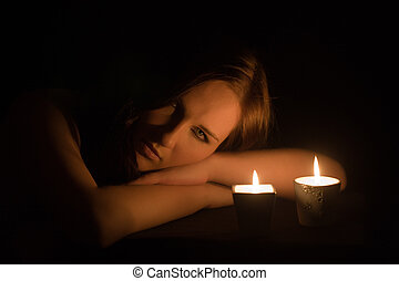 light of candles - Portrait of the romantic girl by the...