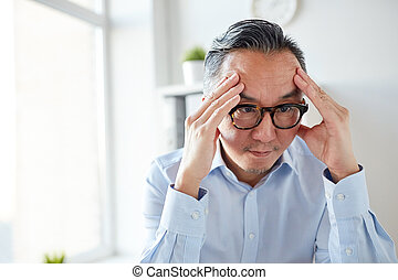 anxious businessman in eyeglasses at office - business,...