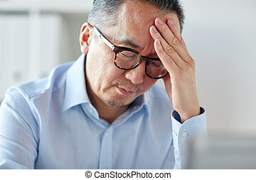 businessman suffering from headache at office - business,...