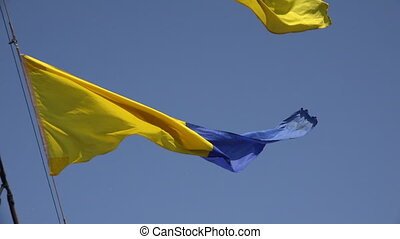 Yellow-blue ensign. A triangle. Shot in 4K (ultra-high...