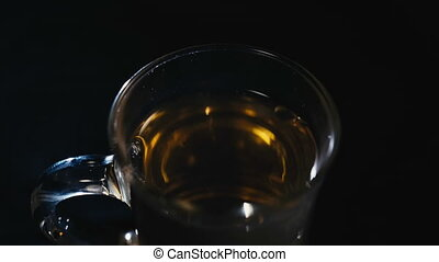 milk poured into a Cup of tea.