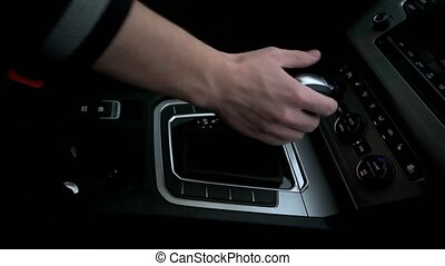 Man puts the gearbox into drive mode.