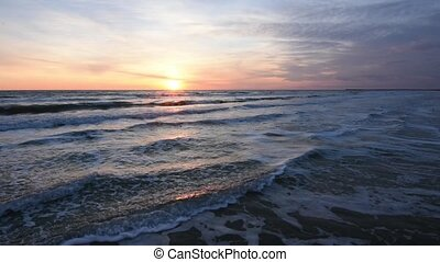 Sunset over the sea, the surf, the Black Sea, Anapa, Russia