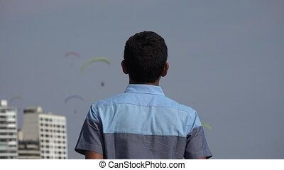 Teen Watching Parasailing