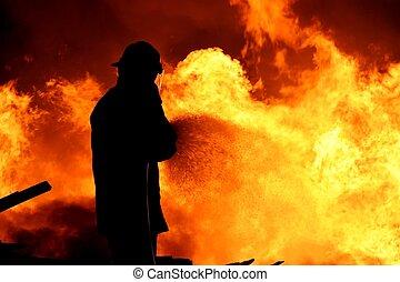 Fireman fighting a fire - Fireman fighting a raging fire...